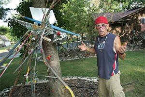 Lewis Greenberg says his front-yard art project is his way of fighting anti-Semitism.