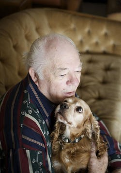 Cowboy, pictured here with his owner Floyd Dunlap, spent most of his life in the kind of puppy mill that would be made illegal by Prop B. State lawmakers are now seeking to gut the voter-approved initiative. - JENNIFER SILVERBERG