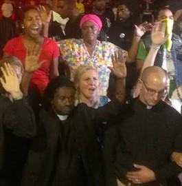 Rev. Sekou (bottom left)