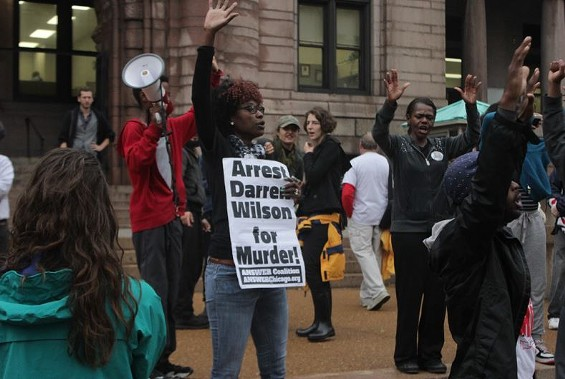 A protester outside St. Louis City Hall says she wants Darren Wilson indicted. But where is he? - DANNY WICENTOWSKI