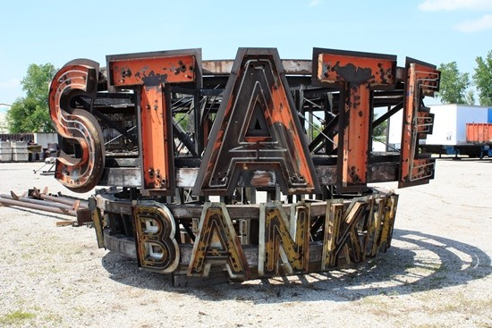 The giant State Bank of Wellston sign, safely removed from its tower. - EXCEPT AS INDICATED, ALL PHOTOS BY CHRIS NAFFZIGER