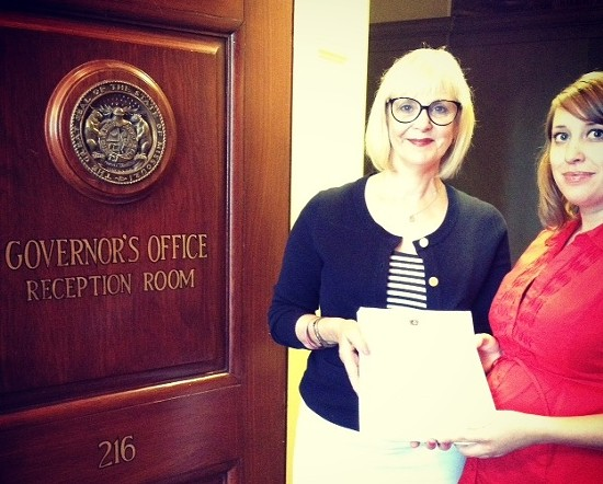 Stacey Newman with the [corrected] constituent services director in the governor's office yesterday. - COURTESY OF NEWMAN