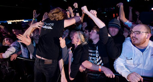 Thursday singer Geoff Rickly leans over the barricade at Pop's on Saturday night. The band headlined the show. See more photos from Saturday night here. - PHOTO: TODD OWYOUNG