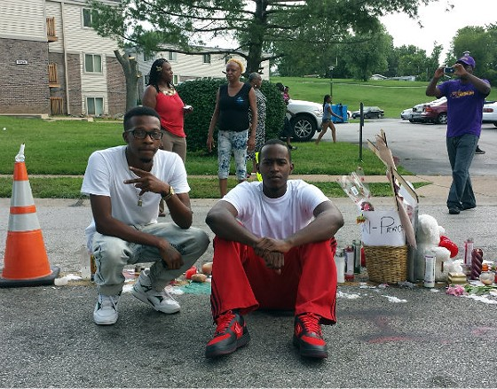 Michael Brown's cousins Maurice Ewings and Anthony Livingston at the spot where Brown was killed. - JESSICA LUSSENHOP