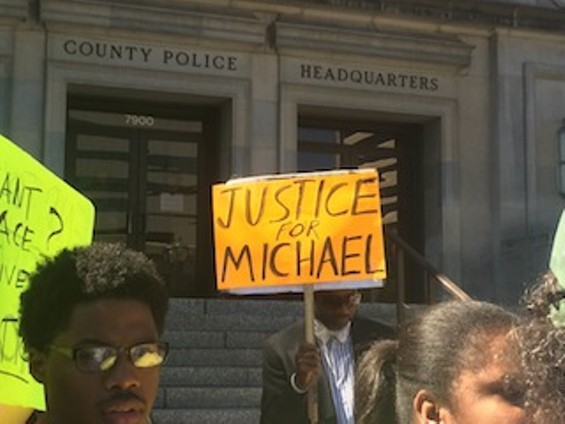 Protesters demand justice for Michael Brown's death Tuesday morning at the St. Louis County Police station in Clayton - PHOTO BY MITCH RYALS