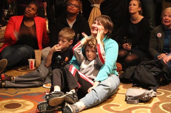 Michael Jones in a blue shirt, and Daniel in his mother's lap. - LEAH GREENBAUM