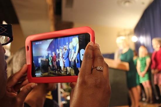 A woman films McCaskill's speech with her iPad. - LEAH GREENBAUM