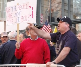 David Goodard, of Piedmont, shouts at pro-health care protesters during President Obama's visit to St. Louis on Wednesday. - AMIR KURTOVIC