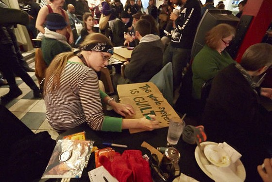 """MoKaBe's served as """"safe space"""" for protesters on November 24, the day of the grand jury's decision. Hours later, police tear gassed the coffeehouse. - THEO WELLING"""