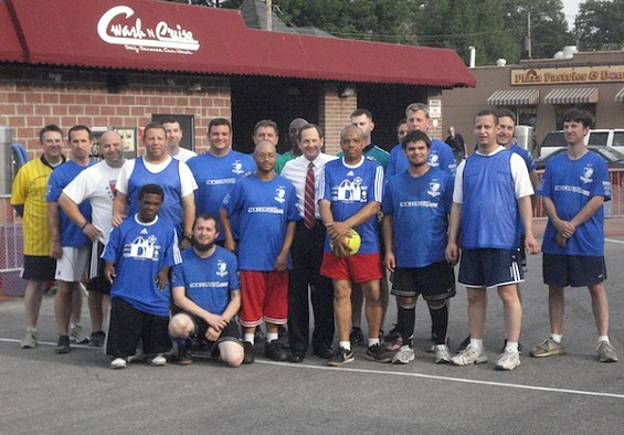 Mayor Francis Slay (center) attended last night's soccer match between the Roadies and the Unsung Heroes.