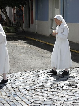 Maybe retired nuns get to sit in the sun all day and drink piña coladas like this sister. - IMAGE SOURCE