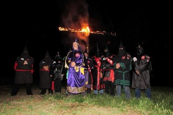 Frank Ancona (center), the head of the Traditionalist American Knights of the Ku Klux Klan, says his group is ready to protect citizens from violent Ferguson protesters. - VIA