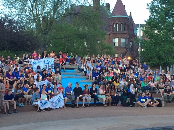 Students and staff at Saint Louis University gather for a candlelight vigil to honor Holocaust Remembrance Day. - LINDSAY TOLER