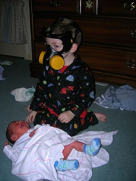 If you have to change a diaper, do this. Don't crush the kid. - IMAGE SOURCE