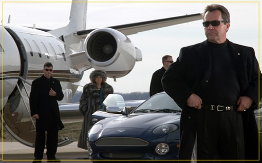 Adams on the right, in a commercial photo for his private investigation company. - JOEADAMSPI.COM
