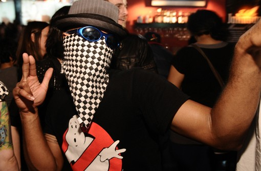 """An incognito, but not inconspicuous, partier poses for a photo on Saturday night at the Halo Bar for the final """"London Calling"""" party there. See more photos here. - PHOTO: EGAN O'KEEFE"""