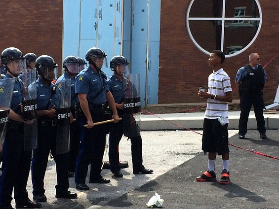 Davion Lorich asks police officers in Ferguson if they feel bad about what happened to Michael Brown. - MITCH RYALS
