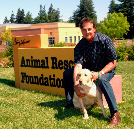 La Russa poses with Mustard outside his animal shelter.