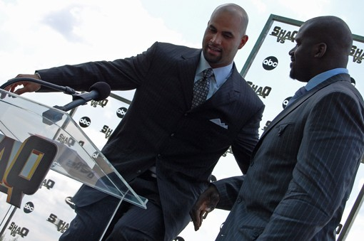 """The 7'1"""" O'Neal helps the 6'3"""" Pujols onto a chair for a photo-op. - PHOTO: NICK LUCCHESI"""