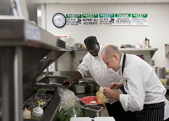 Executive chef Ivy Magruder (front right) with Grand Marche Daniel McDowell in the Panorama kitchen.   Jennifer Silveberg