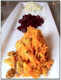 Standout trio: Carrots and raisins, beets in vinaigrette and celery root remoulade. - BRYAN PETERS
