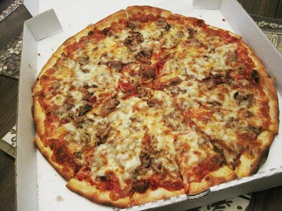 A pizza with sausage and mushrooms from Pizza-a-Go-Go - IAN FROEB