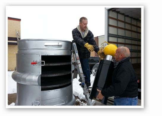 Bringing in the keg smoker.   Jerry Berhorst