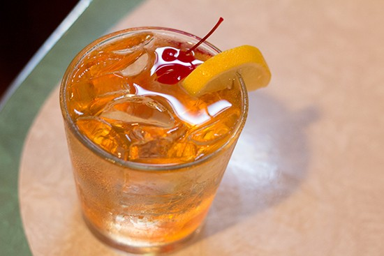 "Tick Tock Tavern's ""VO Highball"" with Seagrams VO, Sprite, lemon and cherry."