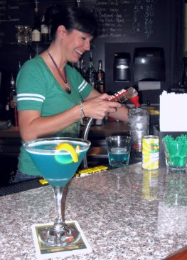 O'Connell pours water to accompany the electric blue Capri Sun cocktail. - ALICE TELIOS