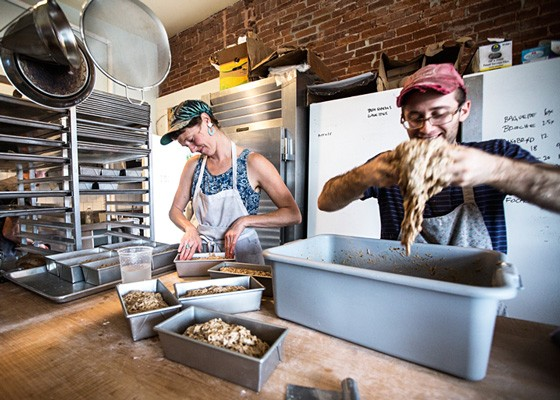 Jenny Wilson and Jake Marks of Red Fox Baking preparing Rugbrød (a Danish bread) in the Grove East kitchen.. | Jennifer Silverberg