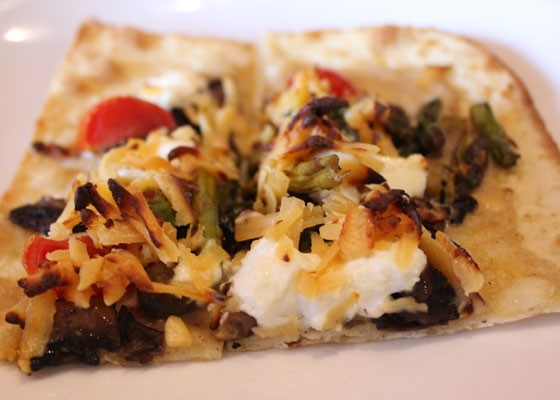 Flatbread with mushrooms, goat cheese, tomato and asparagus. | Nancy Stiles