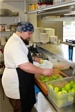 Rick Lewis peeling apples for Quincy Street Bistro's applesauce. - IAN FROEB