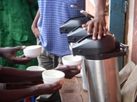 Farmers taking part in a coffee tasting - PHOTO COURTESY SUSTAINABLE HARVEST STAFF