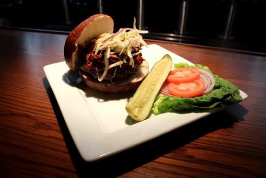 "The ""Carolina"" burger, topped with pulled pork, at Baileys' Range - MABEL SUEN"