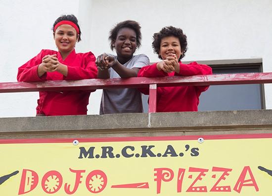 Dojo Pizza volunteers Ashlee Copp, Keisha Regans and Kathryn Copp. | Photos by Mabel Suen
