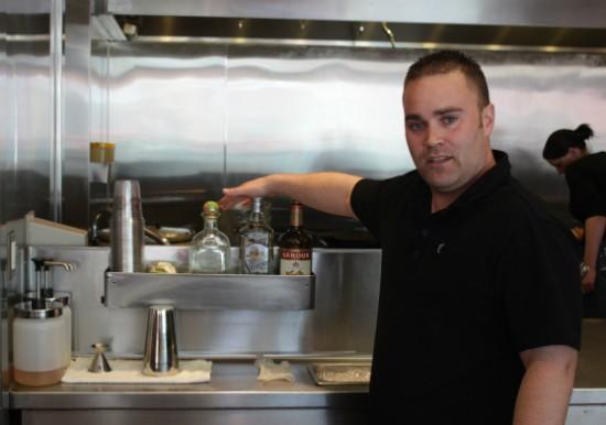 Wayne Prichard, St. Louis marketing strategist for Chipotle, mixes Gut Check a Patron margarita. - LIZ MILLER