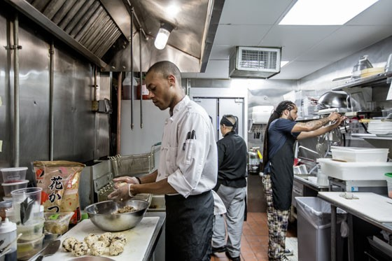 Chef Tyler Davis in the kitchen at Siam. | Jennifer Silverberg