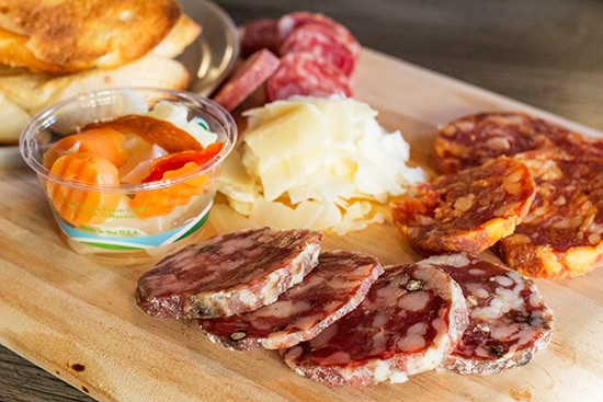 Charcuterie board with pickled vegetables, SarVecchio parmesan and crostini. - PHOTOS BY MABEL SUEN