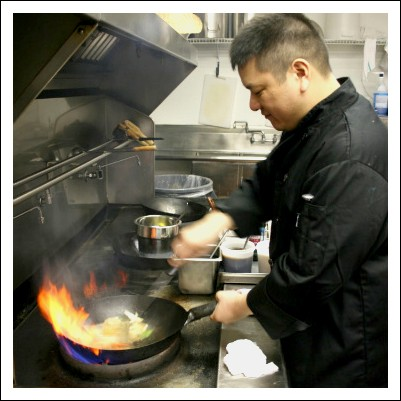 Pearl Cafe chef Scott Truong prepares drunken noodles. - CHRISSY WILMES