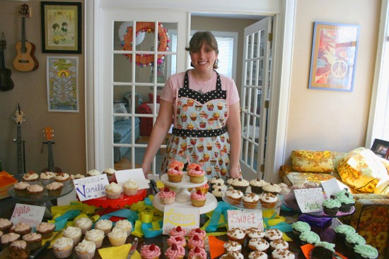 Kaylen Wissinger with a sampling of Farm Fresh Cupcakes in her south-city home. - CHRISSY WILMES