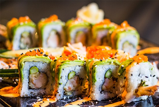 """The """"Goku Roll"""" with shrimp tempura, avocado, red tuna, radish sprouts, masago, baked scallops and spicy crab. 
