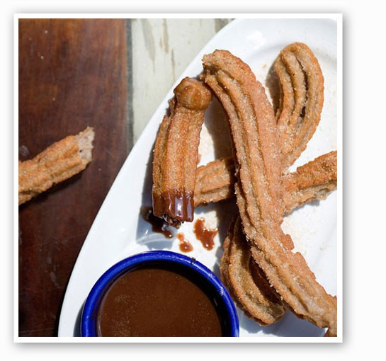Cinnamon-coated churros with chocolate sauce at Mission Taco.   Jennifer Silverberg