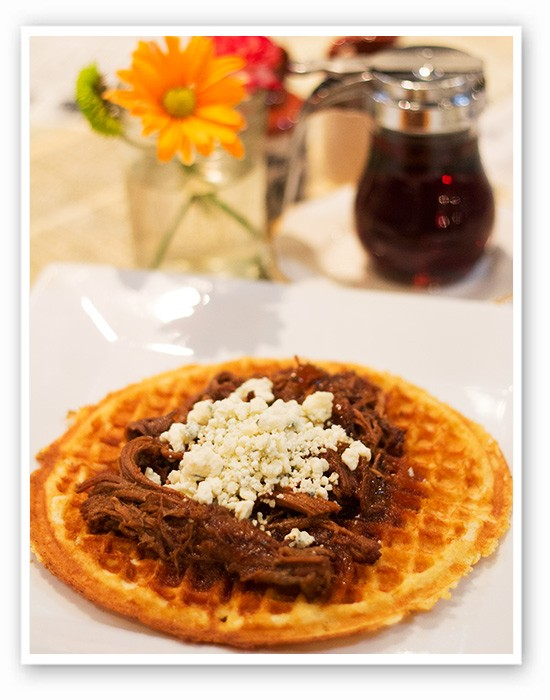 """A """"Blue Ox"""" cornmeal waffle with caramelized onions, slow cooked brisket,bourbon lime sauce and blue cheese. 