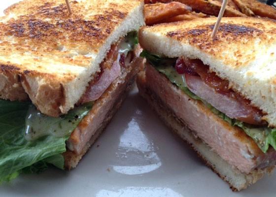 A salmon bacon, lettuce and tomato sandwich with lemon caper aioli. | Nancy Stiles