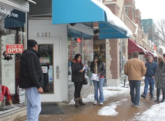 Protesters handed out fliers to passersby and explained why they were upset. | Nancy Stiles