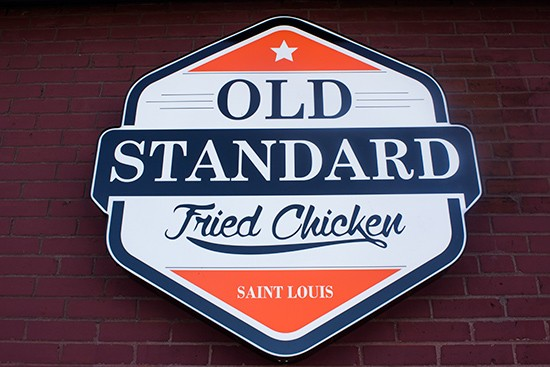The Old Standard logo.