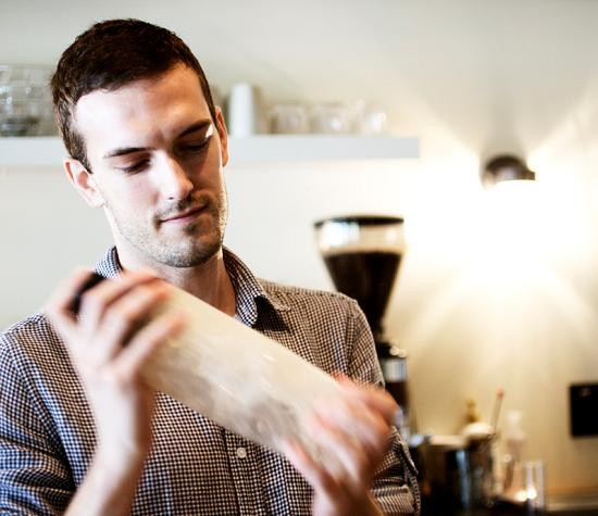 Gabe Kveton, behind the bar of Water Street Café. - JENNIFER SILVERBERG
