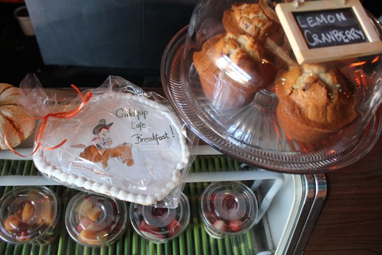 Freshly baked muffins and fruit parfaits at Giddy Up Breakfast Bar. - MABEL SUEN