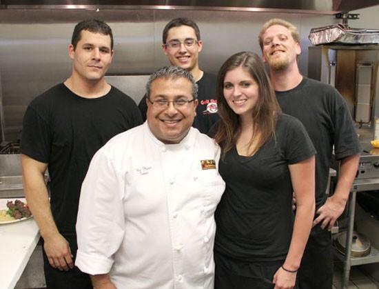 Elie Harir with his staff - KELLY HOGAN