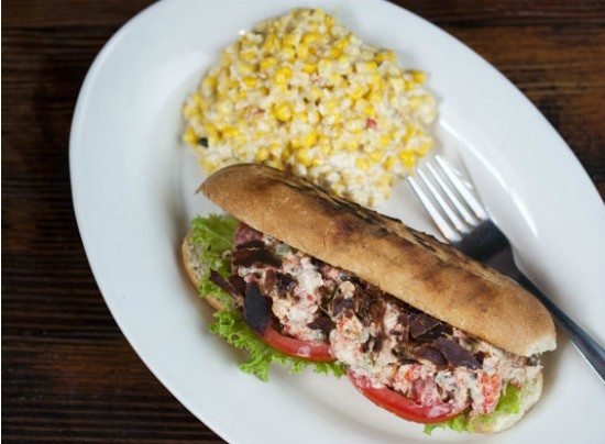 The Crawfish salad sandwich, prepared with oven dried pancetta, tomatoes, and basil with a side of cream corn at Sassy Jac's. - JENNIFER SILVERBERG
